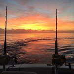 Great day of fishing, beautiful sunrise, adventure of a shark trying to take a tuna!