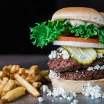 Double grass-fed beef burger with blue cheese, pickles, onion, tomato, and chipotle mayo