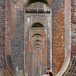 Through the arches of the Ouse Valley Train Viaduct.