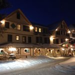 Main lodge at night with lots of snow.