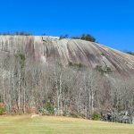 Monothith of the granite dome of Stone Mountain rising above the valley floor.