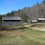 View from the valley towards the barn, corn crib and blacksmith shop.