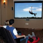 Family enjoys a movie in a vacation home at Zion Ponderosa.