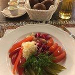 Zakusi, pickled vegetables, black bread in the basket, paprika and basil butter