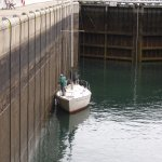 Lock gates are closed and the valves open to fill the lock and lift the boat,