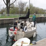 The upstream gates have now been opened and the sailboat is on its way through the lock.