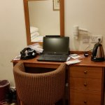 Small desk, fine for single occupancy