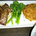steak, spaghetti, and broccolini