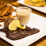 steak with sauce cognac mushrooms