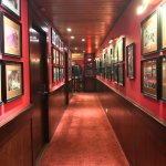 Hallway leading to rooms, decorated with pictures from different eras. Really interesting.