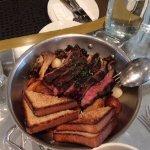 Sunday Brunch...steak, eggs, toast over roasted potatoes, onions and mushrooms