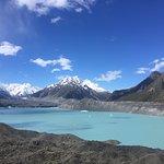 Blue lake, glacier and debris