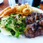Steak with panko prawns and a side of grilled onions & caesar salad