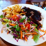 Steak with hickory smoked barbeque sauce and fresh vege slaw
