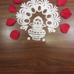 Welcome Kolam decoration on the floor