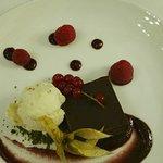 Chocolate torte with cherry sauce and pistachio ice cream