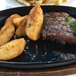 Medium Steak with spicy potato wedges
