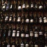 All kinds of wine bottles on the wall in Al Boeuc