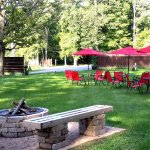 The lower lawn with fire pit and outdoor seating.
