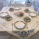 Dining in the Tearoom includes fine china, vintage linens and silver service