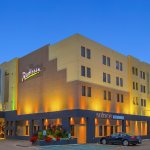 Beautifully landscaped and vibrant colors of the Radisson Red Deer exterior
