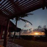 Enjoy a sunset from the Oceanfront Tulum Suite
