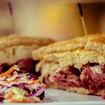 Reuben Sandwich - housemade pastrami with our housemade rye bread, swiss cheese and kraut