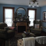 Guest living room with comfy seating, loads of great books and fireplace