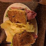 Corned beef sandwich is fully loaded