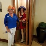 Paula and review writer hanging out at vintage wooden phone booth at the National.
