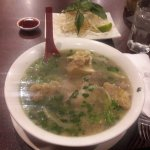 Oxtail pho, in the back, bean sprouts with lime and sauce.