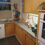 Kitchen (oven, toaster, microwave, large fridge + freezer, coffee machine, kettle, dishwasher)