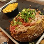 Baked Potato topped with Pork