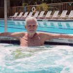 Dad in the heated jacuzzi - Huge pool just behind him