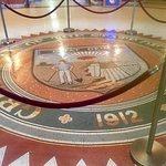 State seal of mosaic on 1st floor.