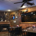 Aft dining room with hunting/fishing lodge-like decor on walls with wall plaque 'quotes'