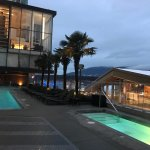 Outdoor pool and hot tub, with views of the Vancouver Convention Centre and the Sea Wall.