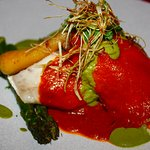 Poached sea bass: pink fir crushed potatoes, grilled asparagus, tomato butter sauce.