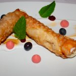 Cannolis: black berry cheese cake, rose meringue & coconut sorbet.