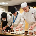 Students preparing dishes for guests at the Debut Restaurant