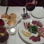 A very nice red wine (their list is great!), delicious bread, and a Charcuterie plate (with duck