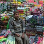 An early morning portrait of a toy vendor in the market