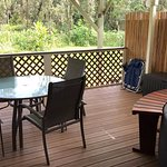 Private backyard deck with soft tub, grill and washer/dryer.