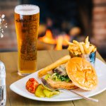 Burger and a Pint in front of the log fire
