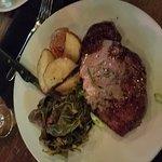 Tuesday steak night  $15 8 oz. potatoes and collard greens.