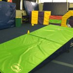 Mats laid out for kids to play on