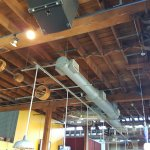 Ceiling of dining area with spindles from when it was a wire factory.