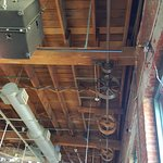 Ceiling of dining area with spindle from when the building was a wire factory.