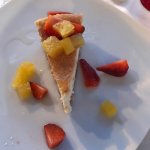 Sour Cream Cheesecake with coconut crust & rum poached pineapple