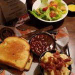 Clucker sandwhich with sides of Baked Beans, side salad and Mac & Cheese with Bacon crumbles!